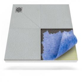 Plato de ducha con membrana impermeabilizante y desagüe puntual descentralizado